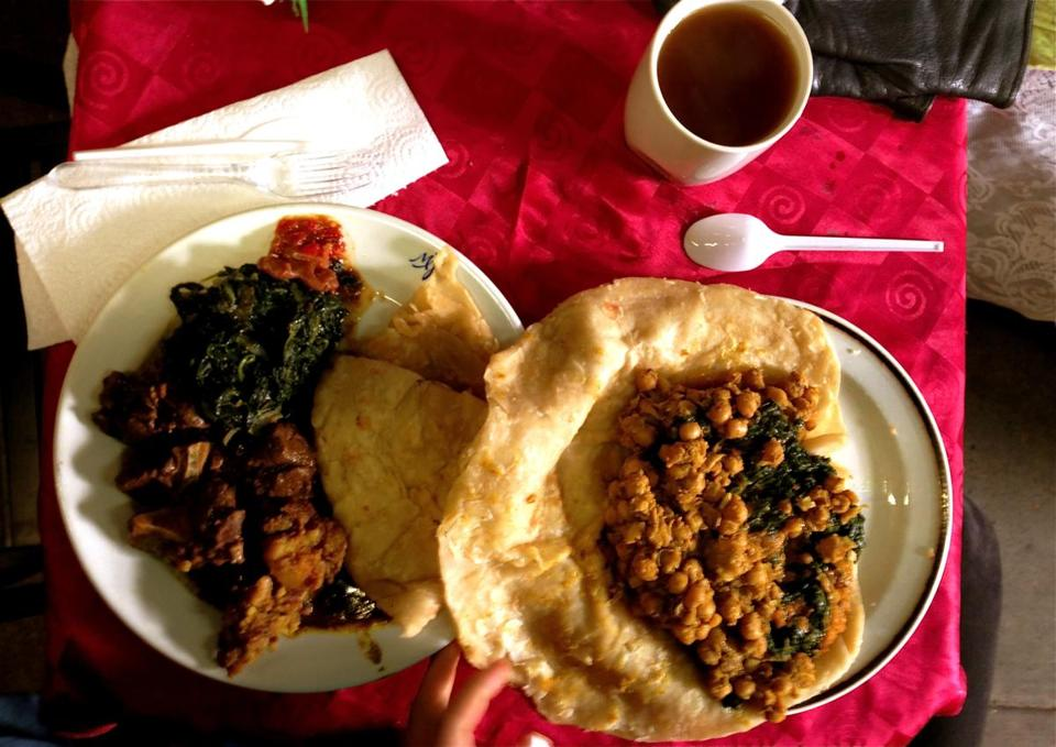 A curry goat roti plate (left) and a chickpea and spinach roti at Guyana Roti.