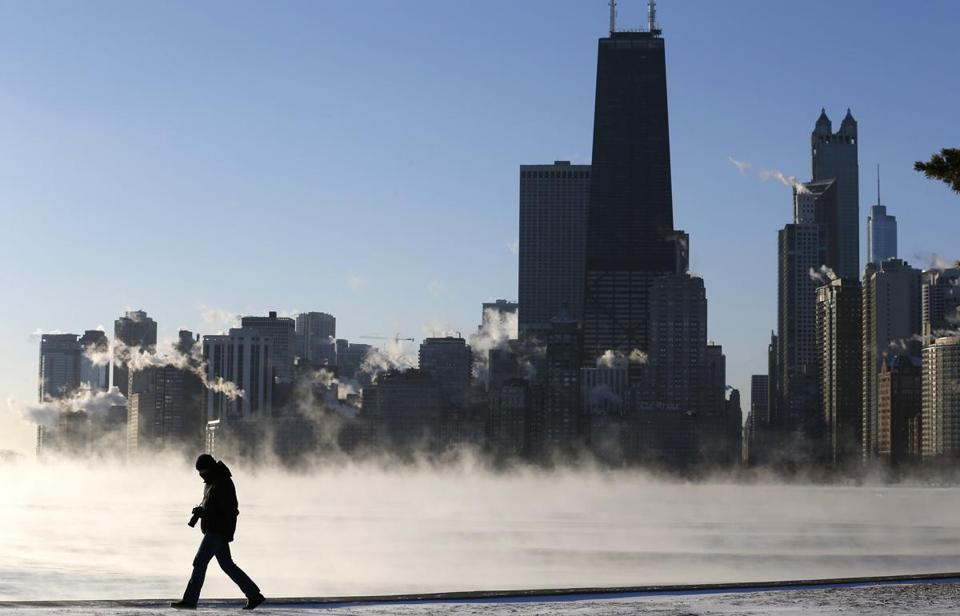 A man was silhouetted against mist risng off Lake Michigan in Chicago on Monday.