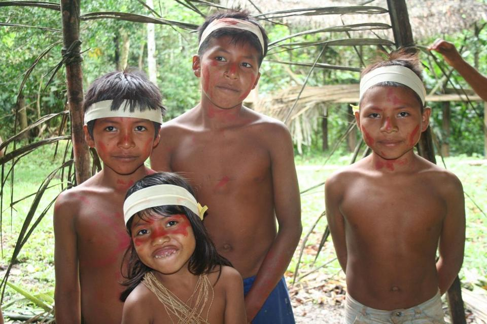 Huaorani children greeted visitors, who are flown into their community in the remote Ecuadorian Amazon.