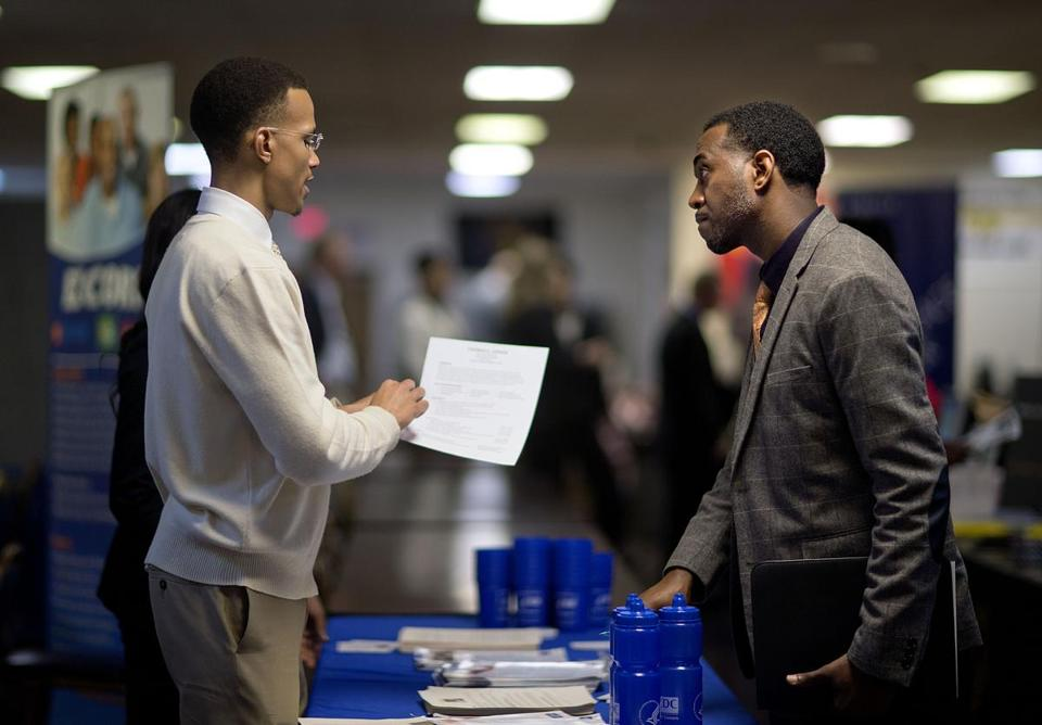 Former Air Force airman Thomas Gipson (right) of Atlanta went over his resume with Ralph Brown, a management analyst, at a recent job fair for veterans in Marietta, Ga.