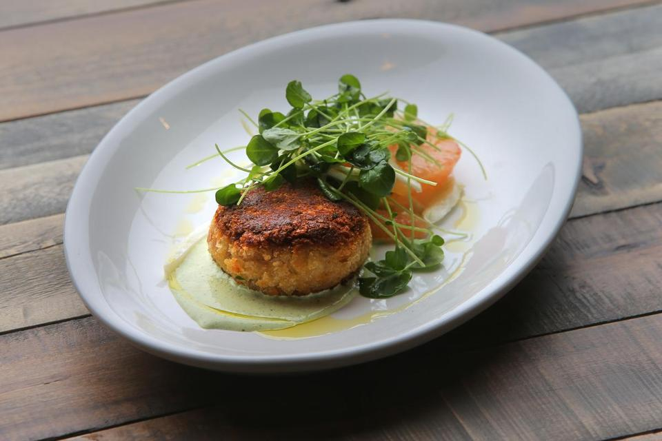 On the Commonwealth menu, a crab cake starter with microgreens, green goddess dressing and grapefruit.