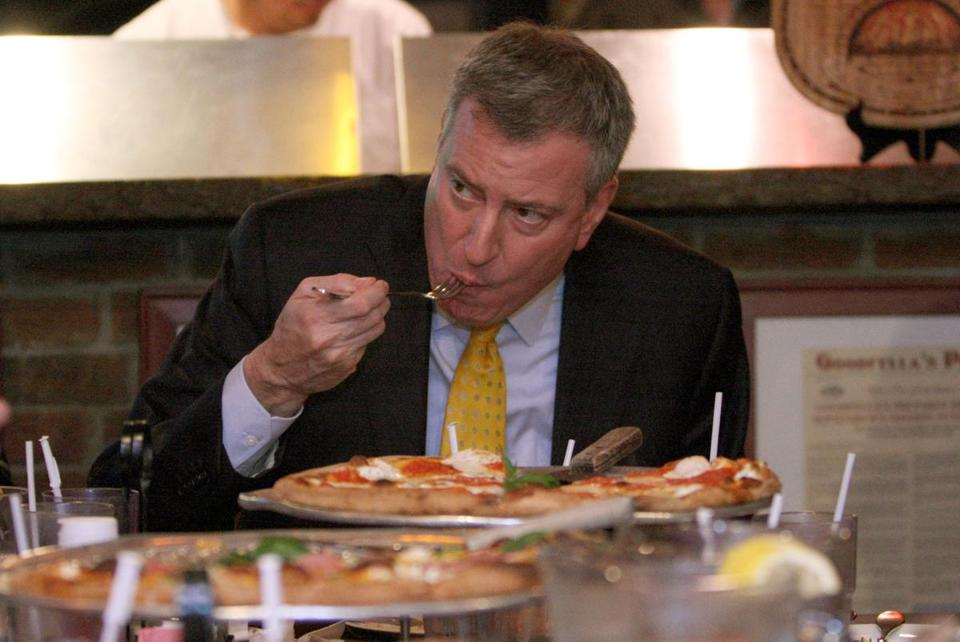 New York Mayor Bill de Blasio ate pizza with a fork at Goodfellas Pizza in Staten Island on Jan. 10, 2014.