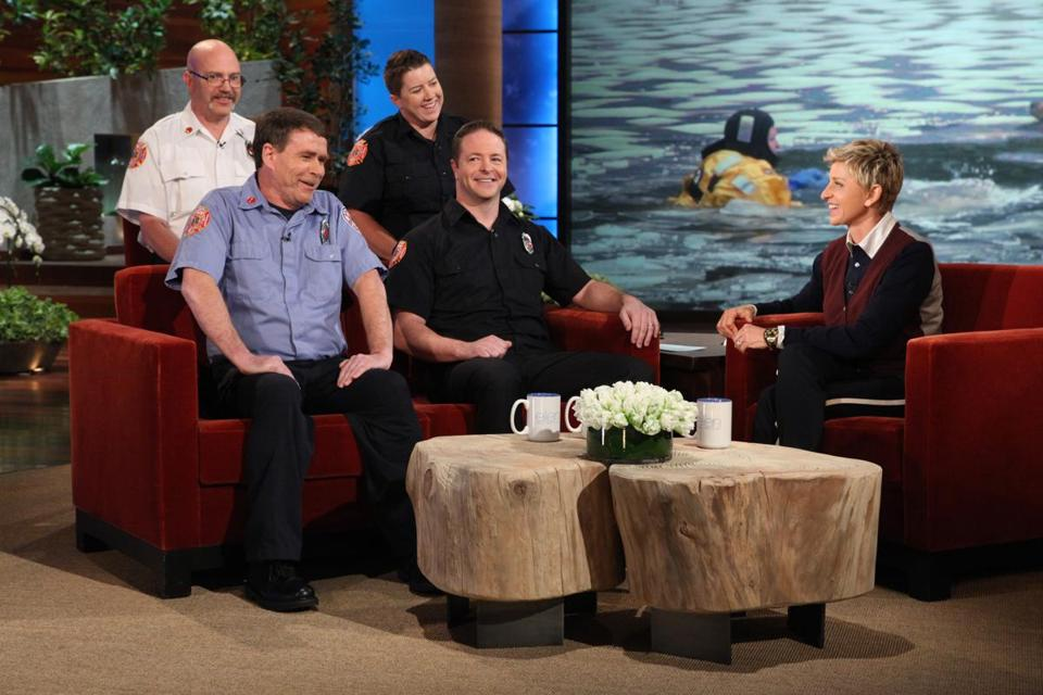 Wellesley firefighters (from left) Jim Dennehy, Lieutenant Paul Delaney, Joan Cullinan, and Dave Papazian with Ellen DeGeneres on her TV show.