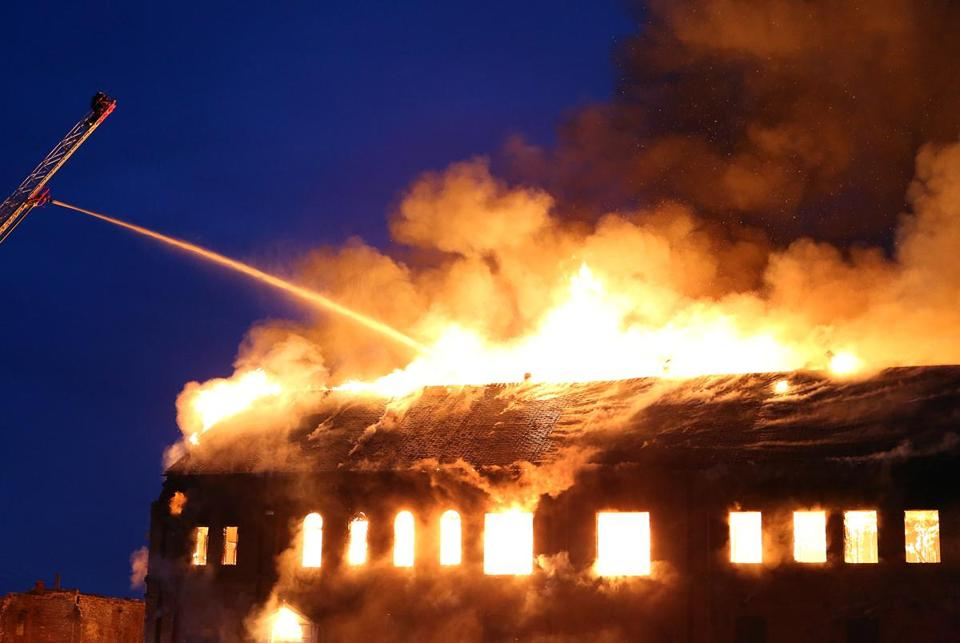 A five-alarm fire gutted the former Merrimac Paper Co. building Monday night.