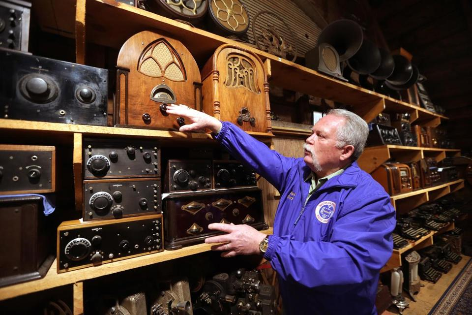 Mark Vess shows off his most recent acquisition, a beautiful and extensive collection of antique radios that belonged to amateur radio operator Bruce Hayden, of Raynham. Mr. Hayden recently passed away and bequeathed his collection to Vess.