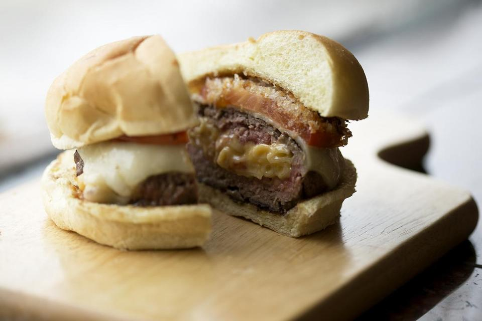 "Dan Whalen cuts mac and cheese and puts it in burgers to make a dish from ""Stuffed: The Ultimate Comfort Food Cookbook."""