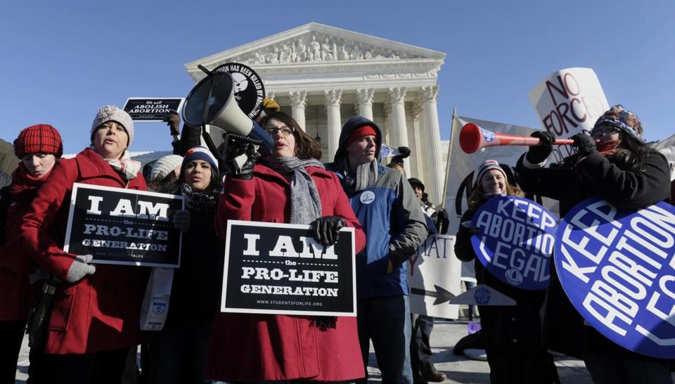 Protesters from both sides of the abortion issue rallied outside the Supreme Court during Wednesday's annual March for Life. The event is held on the anniversary of the decision that declared a constitutional right to abortion.