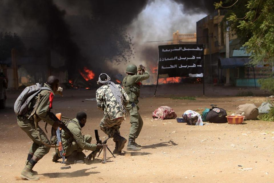 Malian soldiers react to an explosion in the city of Gao in February. The UN has deployed 6,000 peacekeepers to Mali.