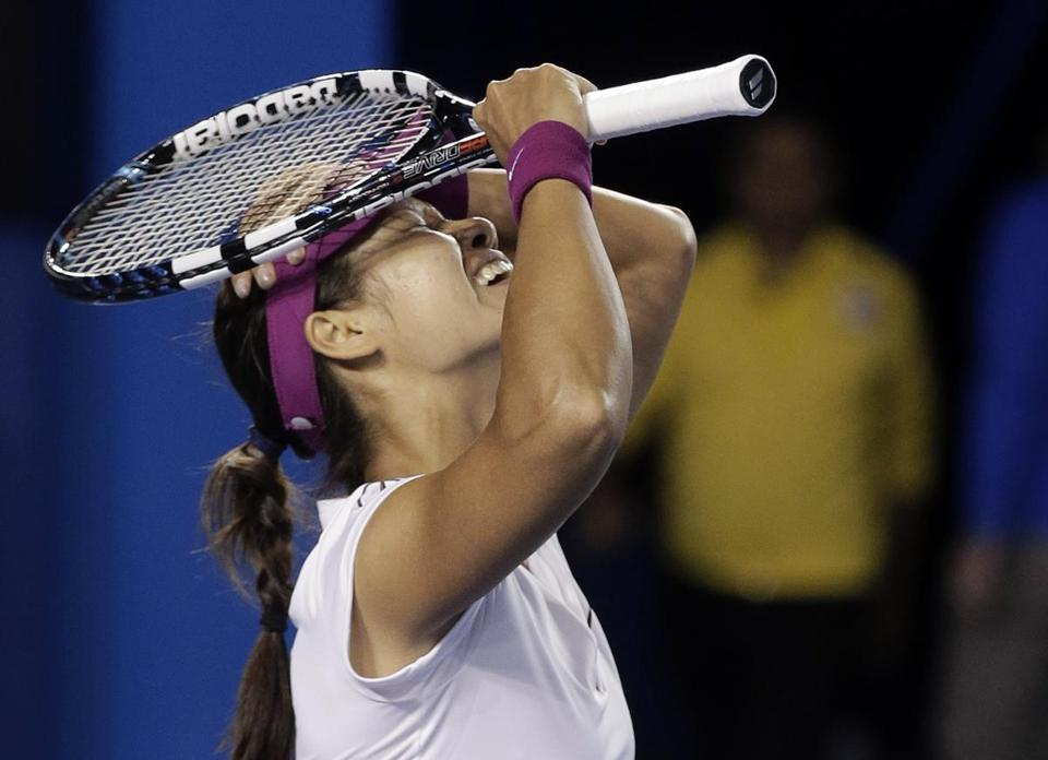 Li Na reacted Saturday after defeating Dominika Cibulkova in the women's singles final at the Australian Open.