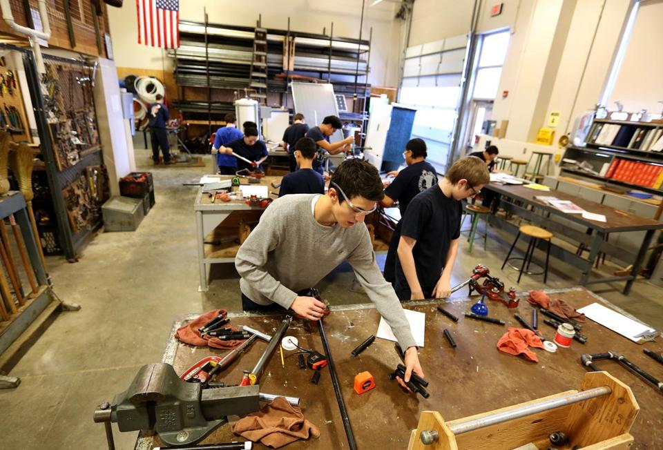 Students worked in the plumbing shop at Worcester Technical High School in 2014.