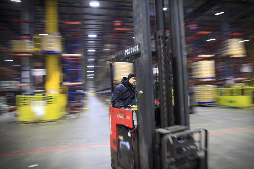 High-lift operator Ernesto Diaz moves produce at Stop & Shop's Freetown facility.