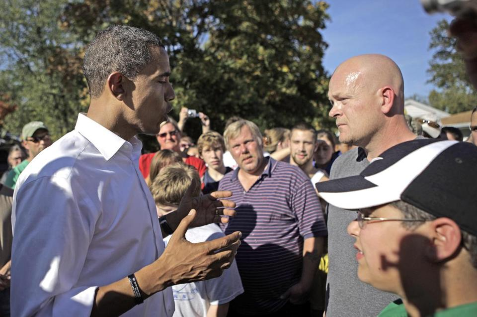 "Then-presidential candidate Barack Obama speaks to Joe Wurzelbacher, later known as ""Joe the Plumber,"" in Ohio in 2008."