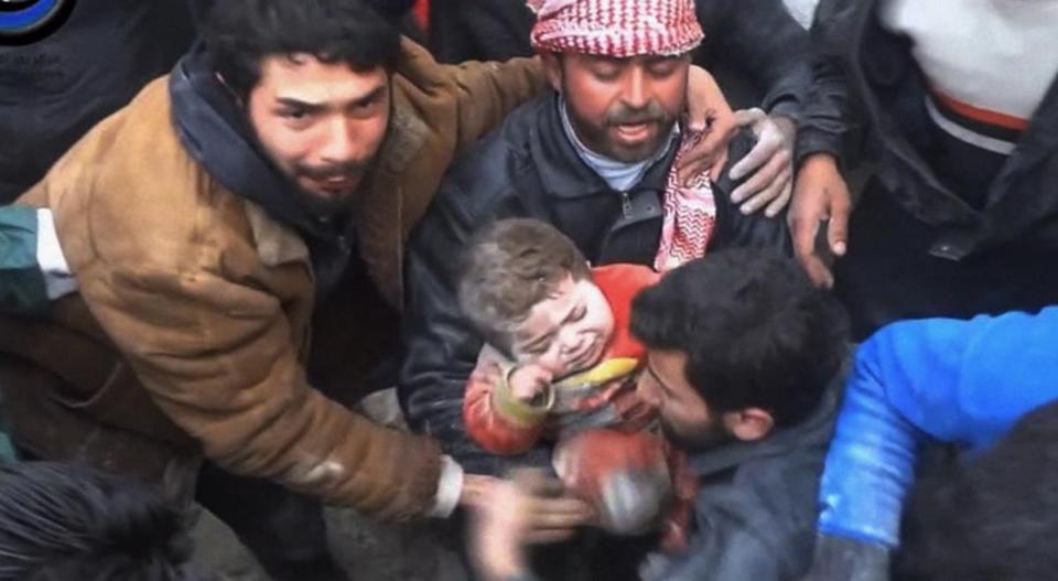A girl was pulled from the rubble of a building in Aleppo, Syria, after it was bombed by the government last month.