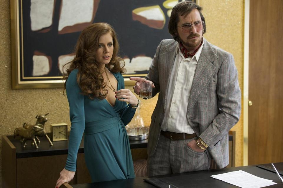 "AMY ADAMS (with Christian Bale) as mistress and wan-nabe stepmother  in  ""American Hustle."""