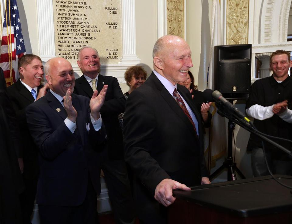 Brockton Mayor Bill Carpenter (left) applauds Bob Hayden at a January press conference. Carpenter wants Hayden named police commissioner for a year.