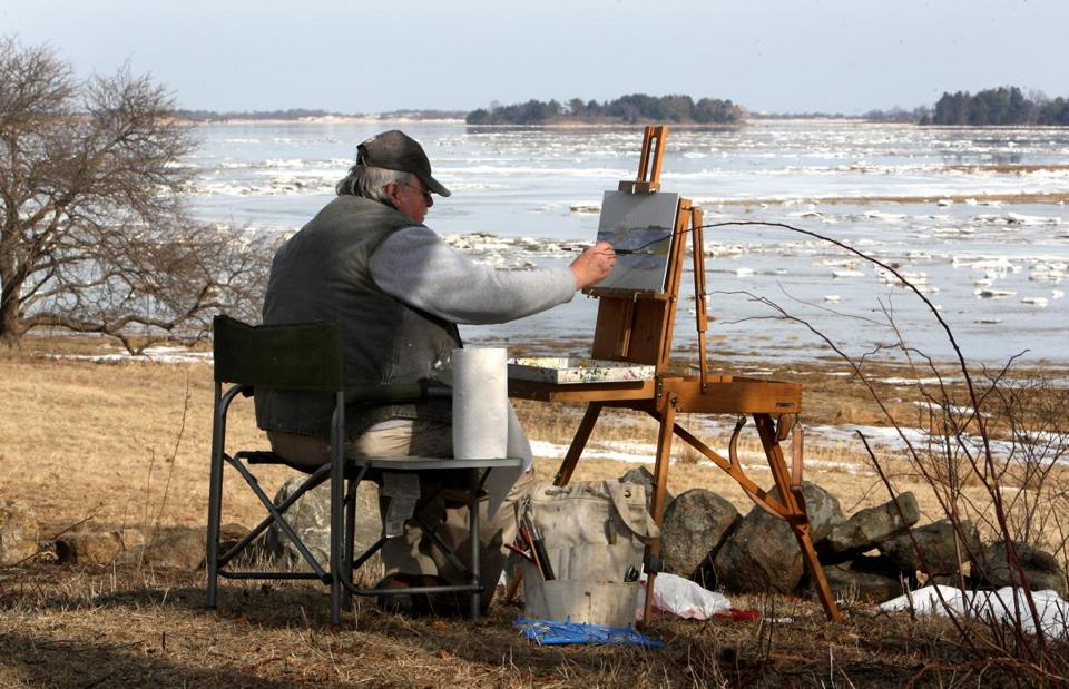 Ice covers the marshes as Chuck Francis of Rockport works in oils at the Cox Reservation in Essex as part of a drop-in class hosted by Gloucester artist David Curtis, which meets every Saturday.