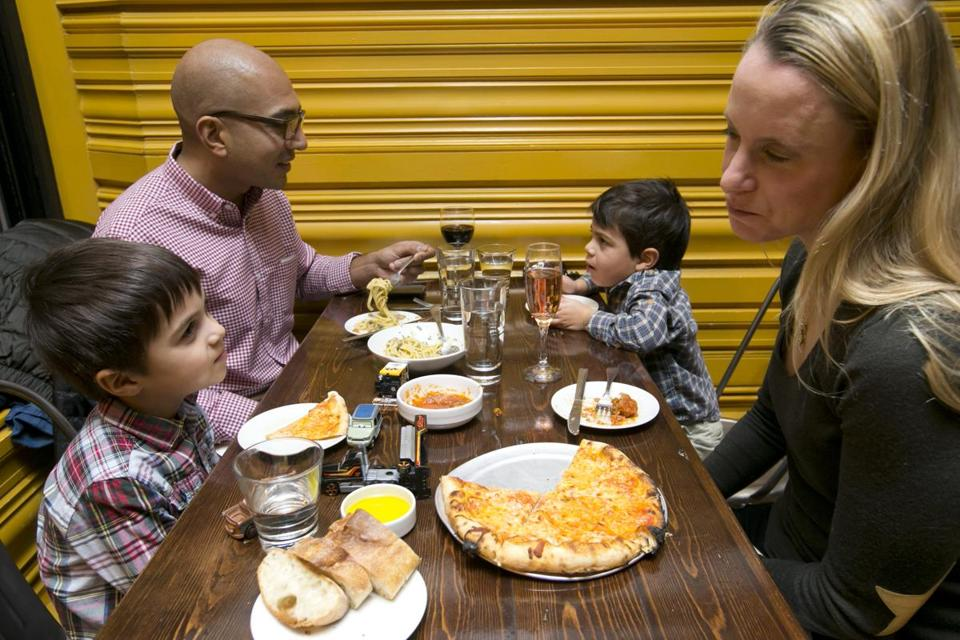"The Patel recipe: ""We go hungry, and we go early."" Clockwise (from left): No-ah, 5, dad Minesh, Devin, 3, and mom Alexandra at Coppa in the South End."