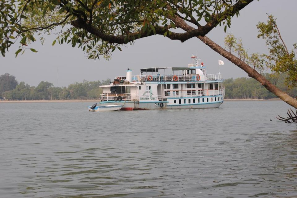 The tour boat explores Bangladesh's Sundarbans mangrove forest, a UNESCO World Heritage Site.