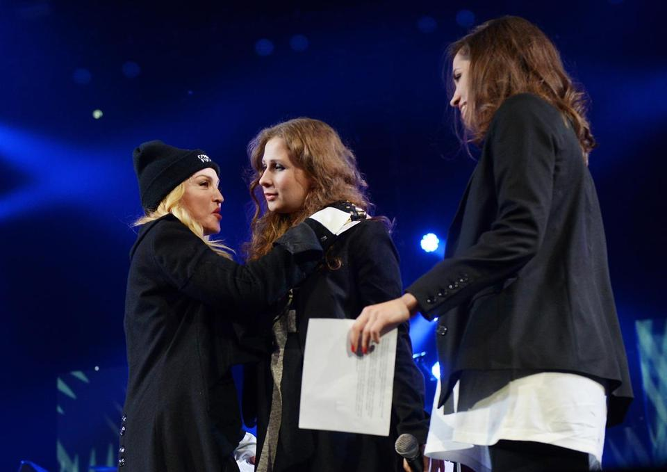 Madonna introduces Maria Alekhina of Pussy Riot at an Amnesty International concert in New York.