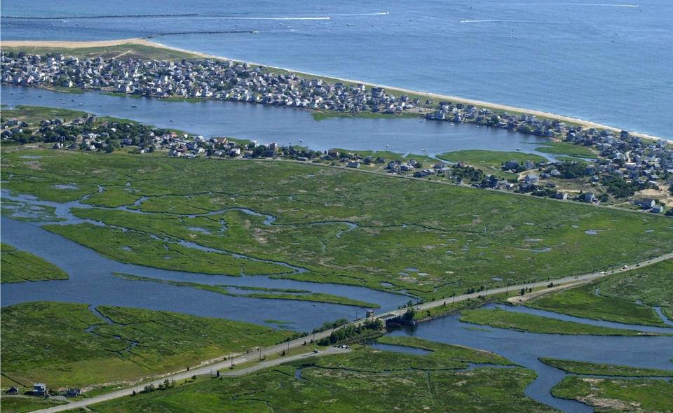 The north end of Plum Island is in Newburyport, where a water/sewer project is the focus of a state investigation.