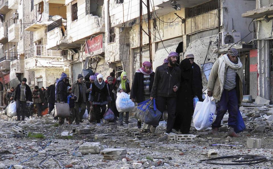 At least 58 people, mostly women, children, and the elderly, were evacuated from a neighborhood in Homs on Friday.