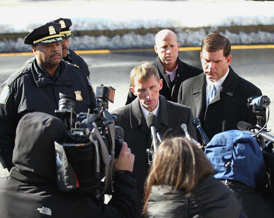 Boston Police Commissioner William Evans spoke at the scene of the fatal shooting as Mayor Martin Walsh (right) looked on.