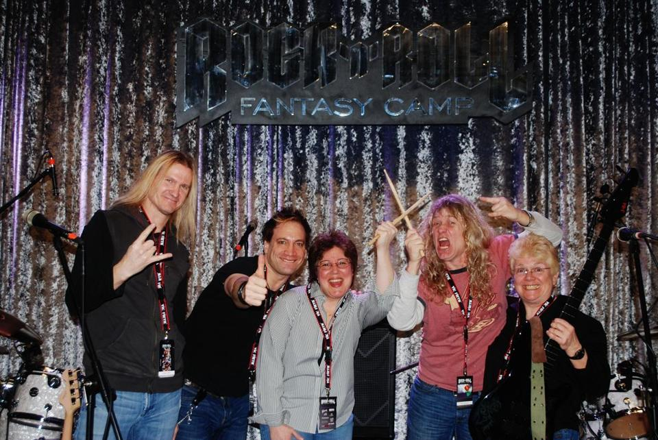 Angela Zarella, center, gave her partner Cindy Walsh, right, an amateur bass player, a ticket to Rock 'n' Roll Fantasy Camp. The photo captures all the players' moods.