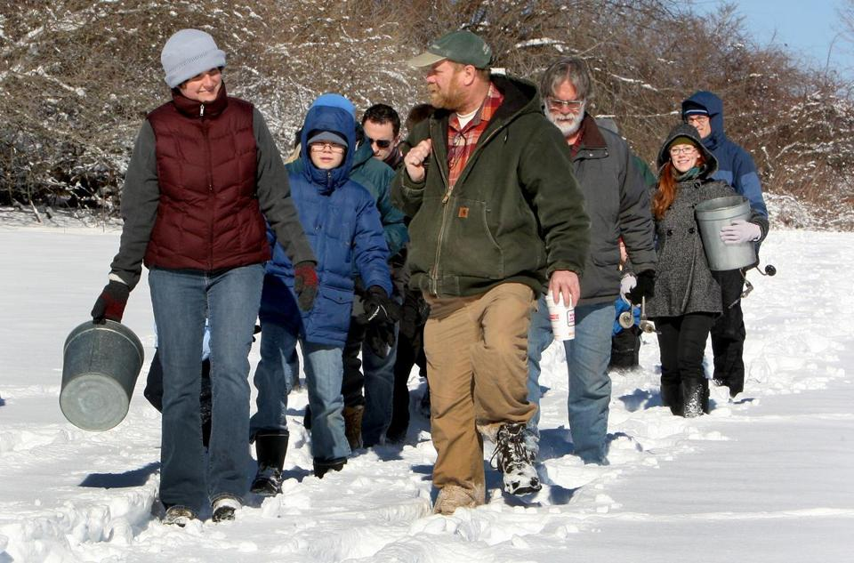 Richard Wolniewicz (center) leads sugaring group at Ipswich River Wildlife Sanctuary,
