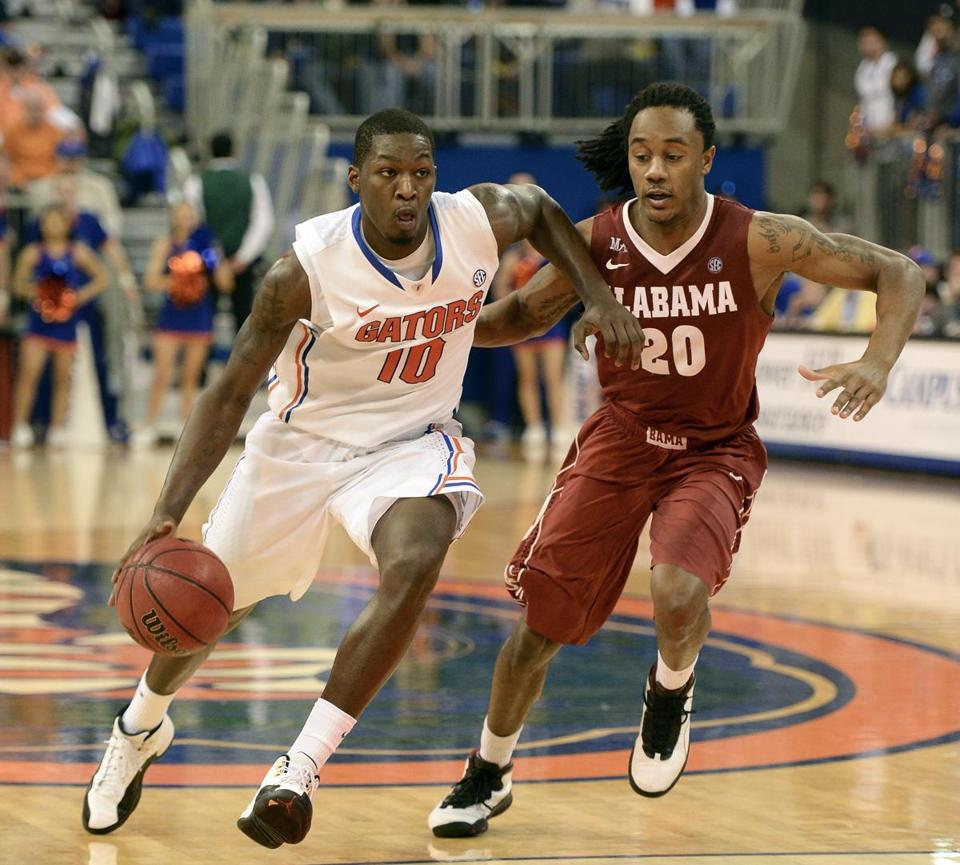 Florida forward Dorian Finney-Smith drove toward the lane as Alabama guard Levi Randolph chased him during the second half.