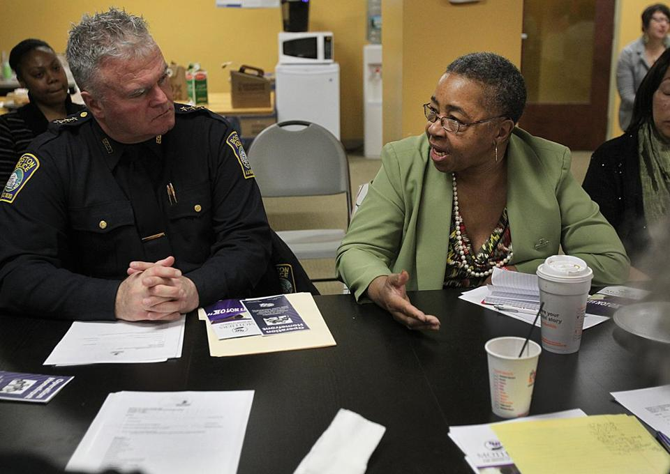 Boston Police Deputy Superintendent Gerard Bailey listened to Sarah Flint, of Mothers for Justice and Equality, in Roxbury.