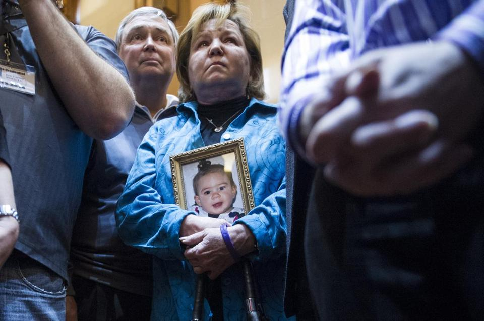 Barbara Kutchback, a medical marijuana advocate, held a photo of her grandchild during a hearing last month at the Georgia State House. The child suffers from a rare form of epilepsy; her family believes marijuana could ease symptoms.