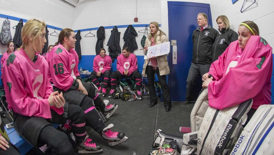 The Austin Prep girls' program has seen a resurgence since Stephanie Wood became coach two years ago.  Here, she talks strategy in the locker room in the game against St. Mary's.