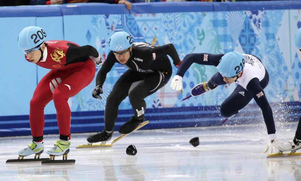 Jack Whelbourne of Britain (right) crashes in the 1,500 short-track race. American J.R. Celski, who finished fourth, is at center, and China's Han Tianyu of China on the left.  (AP Photo/Bernat Armangue)