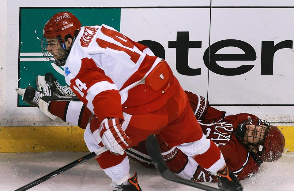 BU's Jake Moscatel left Harvard's Devin Tringale down and out after a first-period hit.