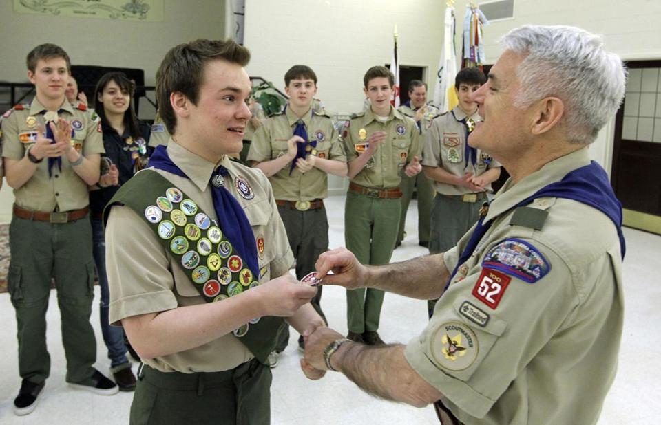 Pascal Tessier, 17, received his Eagle Scout badge from Scoutmaster Don Beckham in Maryland on Monday.