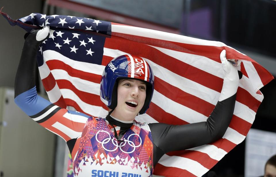 Erin Hamlin waved the flag after finishing her final run Tuesday.
