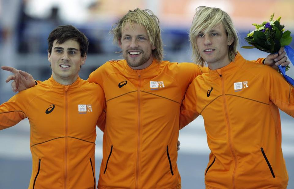 The Netherlands trio of (from left) Jan Smeekens (silver) and brothers Michel (gold) and Ronald Mulder (bronze) were surprise 500 medalists.