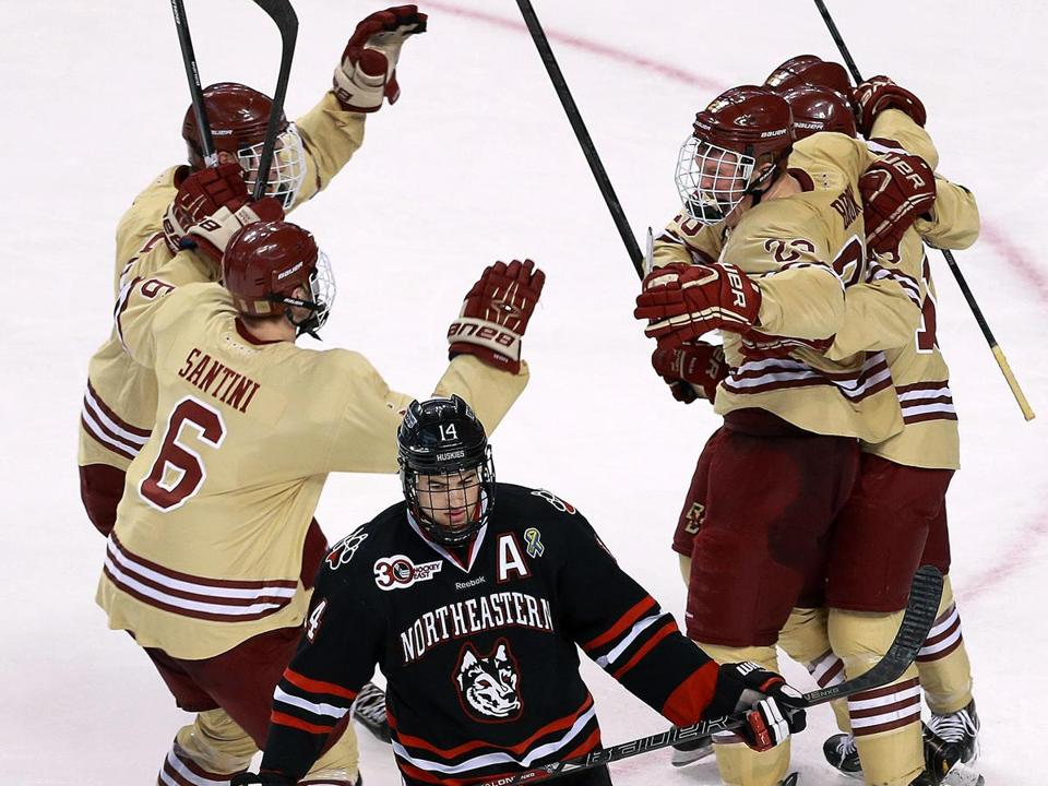 NU's Braden Pimm skates away as Patrick Brown (23) is mobbed after scoring the goal that ended up giving BC a school-record fifth straight Beanpot.