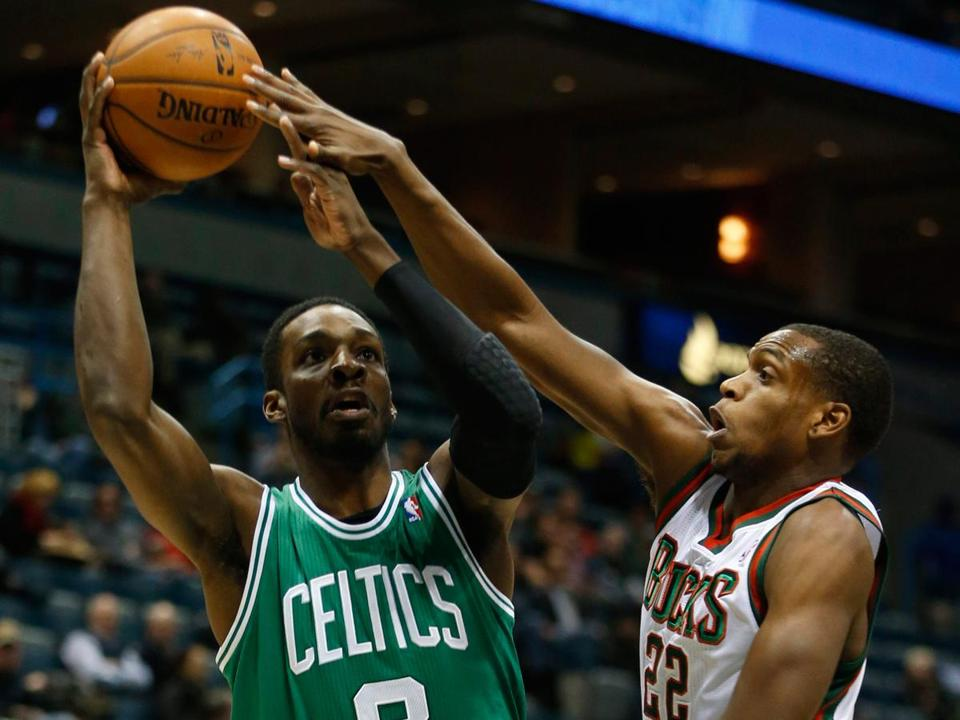 Forward Jeff Green, who finished with 29 points, gets off a shot against the Bucks' Khris Middleton in the first half.