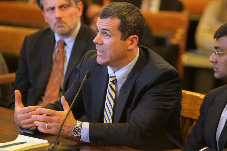 Michael Marino, who formerly oversaw Deloitte's business with Massachusetts government, acknowledged to a Senate panel that better communication would have helped.