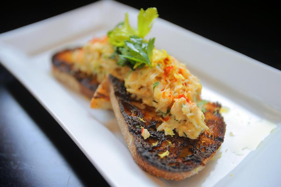 Row 34's crab toast with smoked paprika and celery salad.
