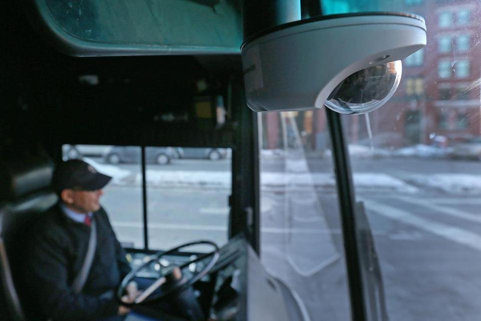 MBTA driver Abdenour Elmahil waited for passengers at the Broadway bus stop on a bus that was recently outfitted with a camera (above) and video monitor. The images are streamed to monitors in a T dispatch center.