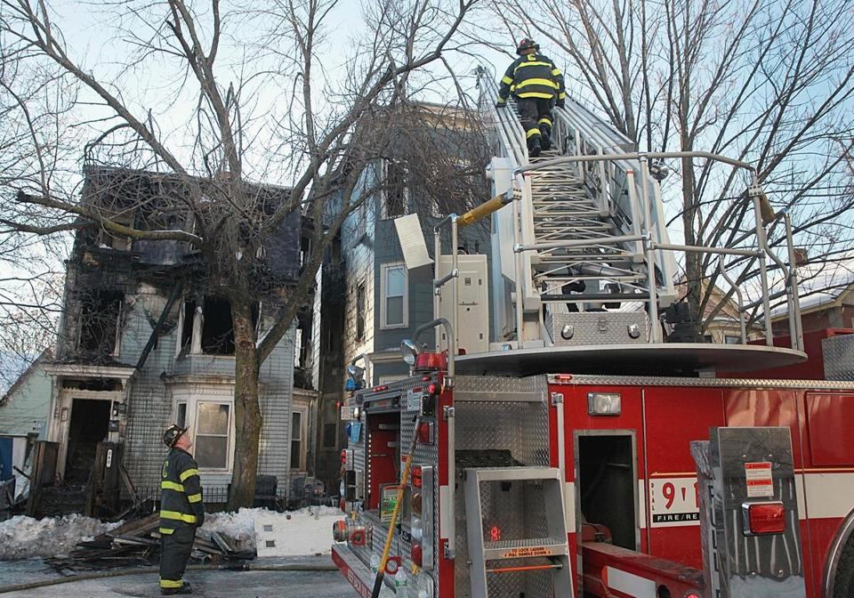 Firefighters responded to a three-alarm blaze in Cambridge on Wednesday that killed a woman.