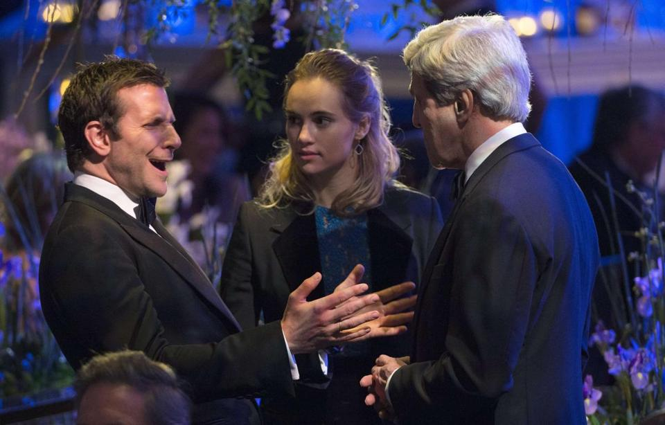 Actors Bradley Cooper (left) and Suki Waterhouse and US Secretary of State John Kerry at the White House.