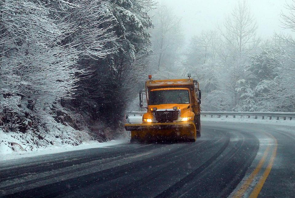 A truck plowed along Highway 75 near Helen, Ga., Tuesday. Sleet and freezing rain were expected overnight.