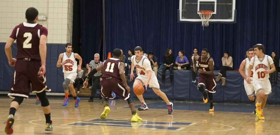 Maimonides School senior captain Yoni Klausner (44) brings the ball up court against St. Clement High School.