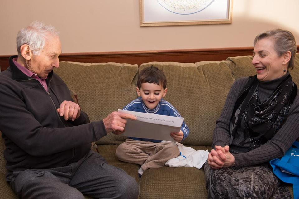 Harold Grinspoon and Marcie Greenfield Simons read to Natick 3-year-old Jake Kotin.