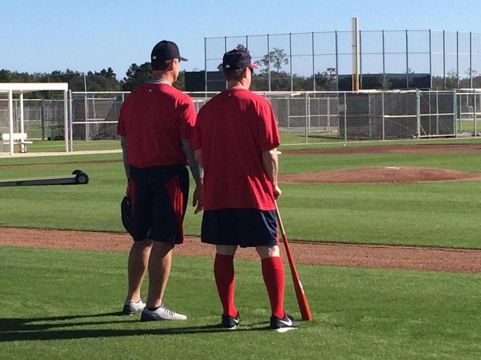 Red Sox coach Brian Butterfield, right, watches over a pre-camp workout with manager John Farrell.