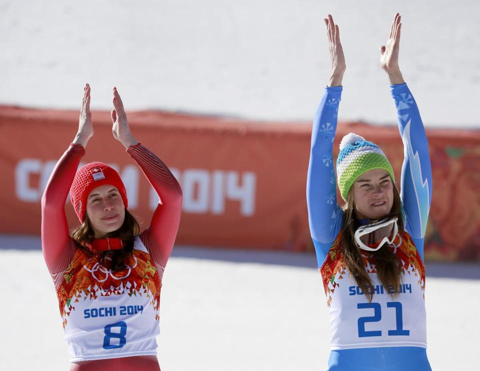 Women's downhill gold medalists Dominique Gisin of Switzerland, left, and Slovenia's Tina Maze.
