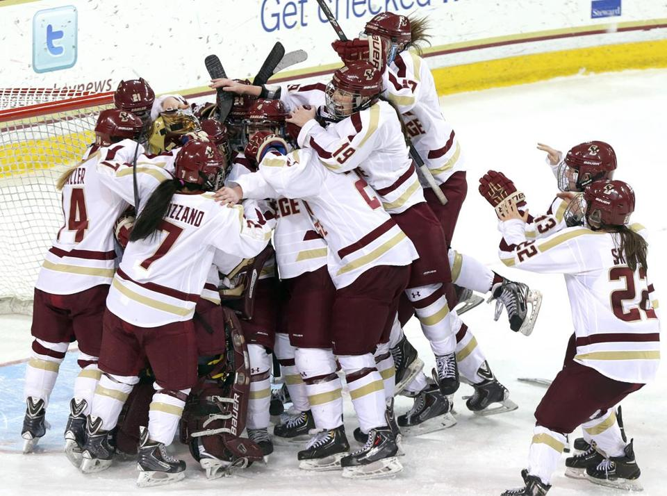 The Eagles flock to goalie Corinne Boyles after BC shut out Northeastern to win the Women's Beanpot Tuesday night.